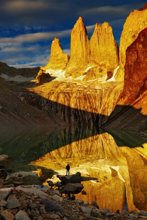 Towers with reflection at sunrise, Torres del Paine National Park, Patagonia, Chile Stock Photo