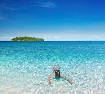 andaman: Woman swimming with snorkel, Andaman Sea, Thailand Stock Photo