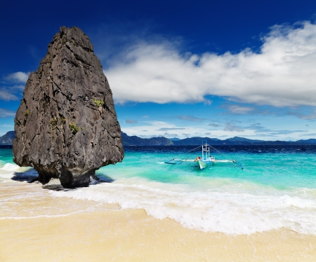 Tropical beach with bizarre rocks, El Nido, Philippines photo
