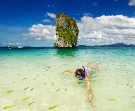 sky dive: Woman swimming with snorkel, Andaman Sea, Thailand Stock Photo