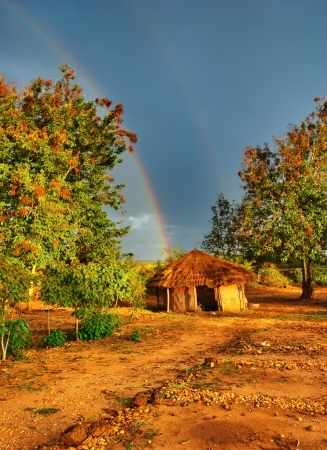 African hut, Rainy season, Uganda  Stock Photo