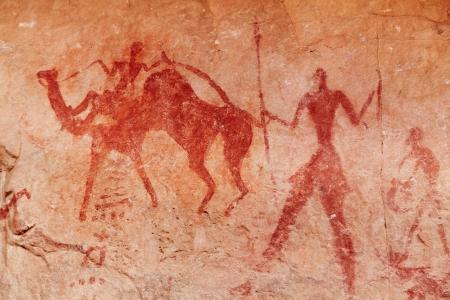 アルジェリアのタッシリ N Ajjer の有名な先史時代の岩絵 写真素材