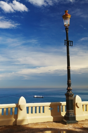 Street lamp in front of the sea, Algiers, Algeria photo