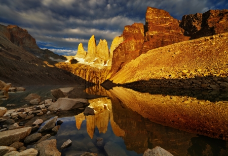 torres del paine: Towers with reflection at sunrise, Torres del Paine National Park, Patagonia, Chile Stock Photo