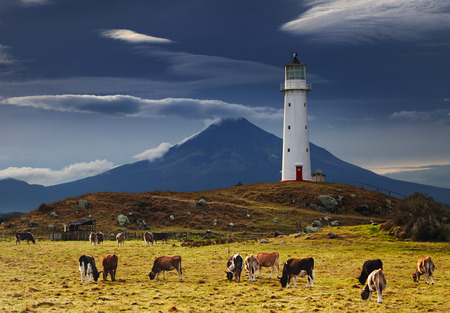 Cape Egmont Lighthouse and Taranaki Mount on background, New Zealand