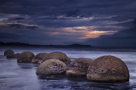 new zealand beach: Moeraki Boulders at sunrise, South Island, New Zealand Stock Photo