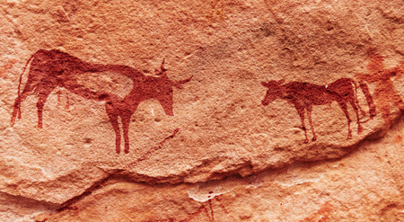 Ancient rock paintings in Sahara Desert, Tadrart, Algeria Stock Photo
