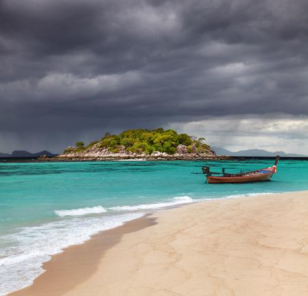Long tail boat, Tropical beach, Andaman Sea, Thailand photo