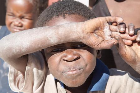 poor african: Namibia- MAY 06, 2007: African children living in a poor village near Kalahari Desert