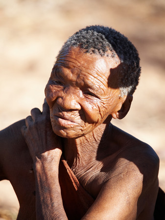 kalahari: Namibia- MAY 06, 2007: Bushman elderly woman May 6, 2007 in Namibia, Kalahari Desert. Bushmen are an indigenous people of southern Africa that living in Namibia, Botswana and some another countries Editorial