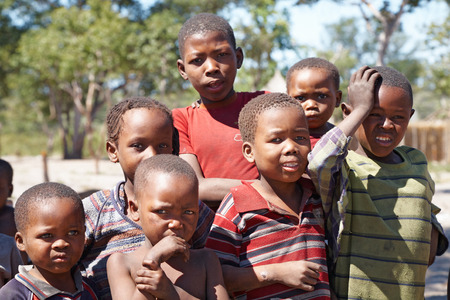 Namibia- MAY 02, 2007: Group of african children living in a poor village near Kalahari Desert, May 2, 2007 in Namibia