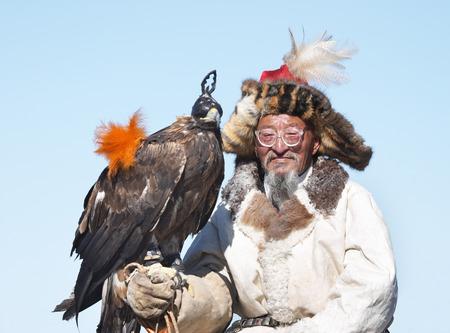 nomadism: Old-man eaglehunter-berkutchi with golden eagle