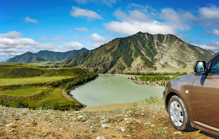 Car at edge of steep river bank photo