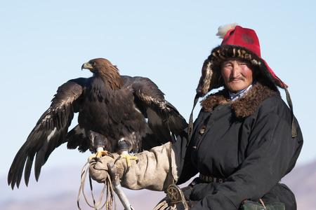 Old-man eaglehunter berkutchi with golden eagle, Mongolia