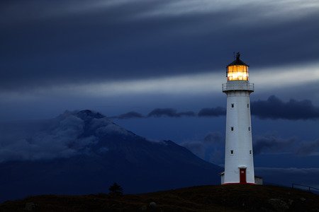 beacons: Cape Egmont Lighthouse and Taranaki Mount on background, New Zealand