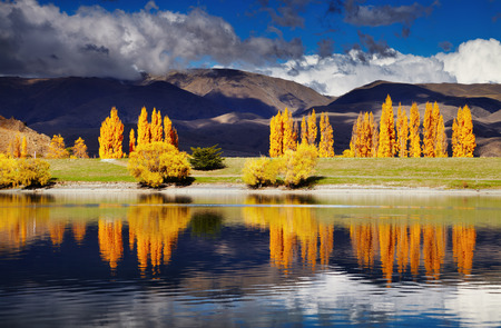 Mountain landscape in autumn colors, Lake Benmore, New Zealand photo