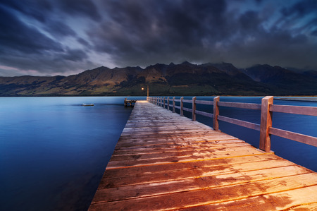 jetty: Wooden pier, Wakatipu Lake at dawn, Glenorchy, New Zealand