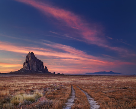 Shiprock, the great volcanic rock mountain in desert plane of New Mexico, USA 스톡 콘텐츠