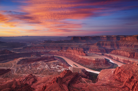 alpenglow: Colorful sunrise at Dead Horse Point, Colorado river, Utah, USA