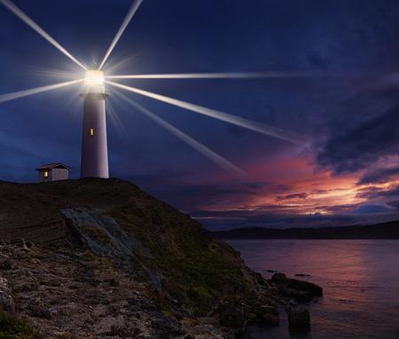Lighthouse on the island against night sky Foto de archivo