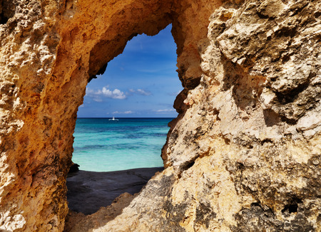 limestone: Tropical beach, view through a hole in the rock, Boracay island, Philippines