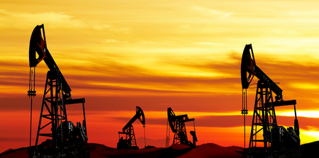 Oil pumps silhouette at colorful sunset Stock Photo