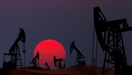 Oil pumps silhouette at  sunset Foto de archivo