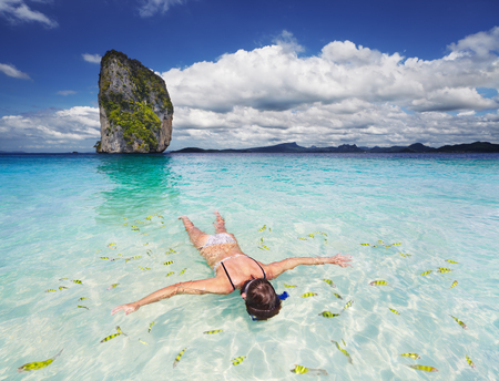 Woman swimming with snorkel, Andaman Sea, Thailand 스톡 콘텐츠