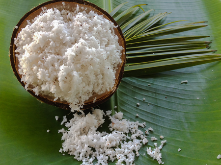 coconut milk with coconut flakes and leaves isolated on banana leaves. copy space