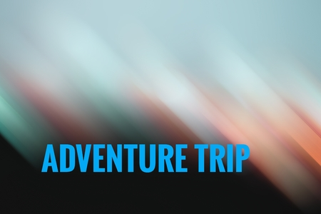 purchasing power: concept light motion with word ADVENTURE TRIP