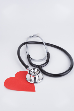 Healthcare Concept stethoscope and Love Red Paper with isolated white background Stock Photo
