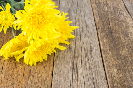 yellow flowers on the wooden table with copy space for word