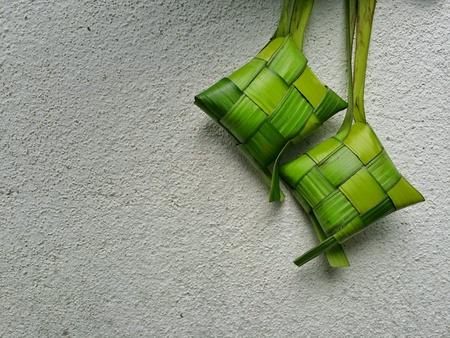 Ketupat rice dumpling on isolated white background.