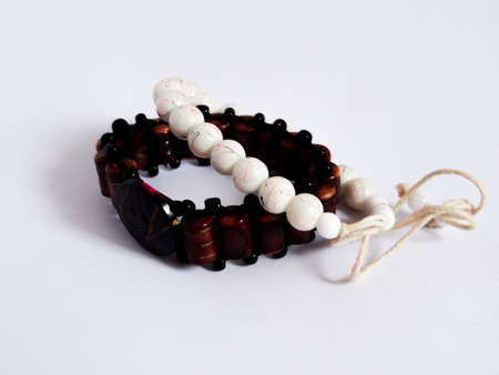 bracelet in batik, wood on white background