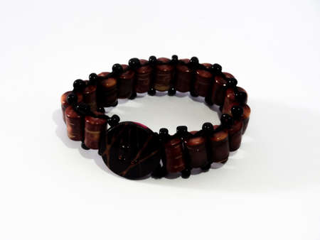 bracelet in brown wood and pink on white background