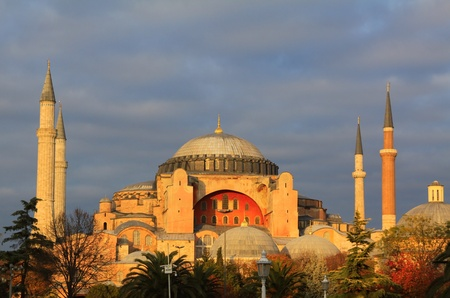 Byzantine architecture of the Hagia Sophia ( The Church of the Holy Wisdom or Ayasofya in Turkish ) illuminated at dusk, famous historic landmark and world wonder in Istanbul, Turkey