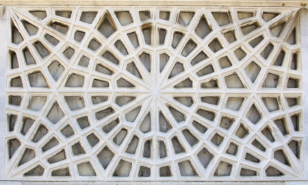 geometric shapes: Old carving decorations on the white stone  Stock Photo
