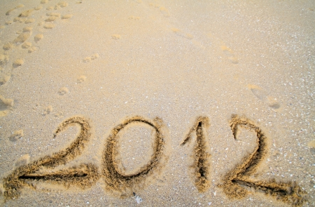 The inscription on the sand - 2012, the old year  Background   photo