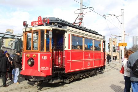 Red vintage tram on Taksim square in Istanbul, Turkey