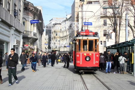 Red vintage tram on Taksim square in Istanbul, Turkey  Stock Photo - 17436953