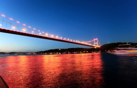 mehmet: Night view of Fatih Sultan Mehmet Bridge in Istanbul, Turkey  Stock Photo