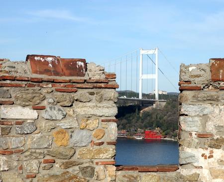hisari: Rumelihisari with the Fatih Sultan Mehmet Bridge in the background in Istanbul, Turkey Stock Photo