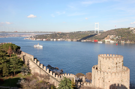 rumeli: Rumelihisari with the Fatih Sultan Mehmet Bridge in the background in Istanbul, Turkey Editorial