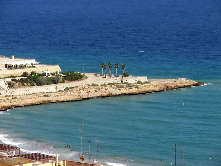 Urban beach on Mediterranian Sea protected by a long cape  Stock Photo