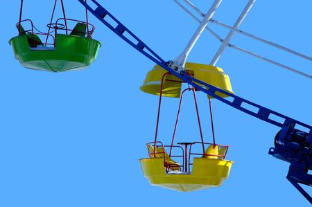 A couple of whirligig cabins against the sky Stock Photo