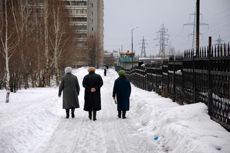Three old ladies walk in the town park