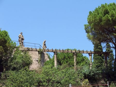 Two statues of holies guard an ancient aqueduct on the Monserrat