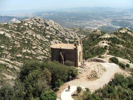 Meandering path to the top of the Monserrat mountain. The road of piligrims and tourists. Stock Photo