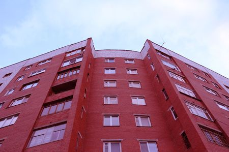 View of red brick block of flats typical for Russian cities Stock Photo