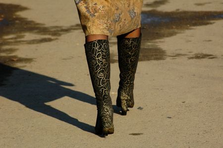 Stylish embroidered leather boots fit closely to ladies legs Stock Photo
